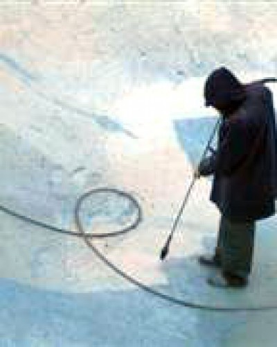 photo of water-blasting-old-pool-paint
